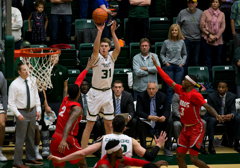 . Colorado State\'s Adam Thistlewood (31) fires a three-point shot against New Mexico Saturday afternoon Jan., 12, 2018 at Moby Arena in Fort Collins. The Rams beat the Lobos 91-76. (Michael Brian/For the Reporter-Herald)