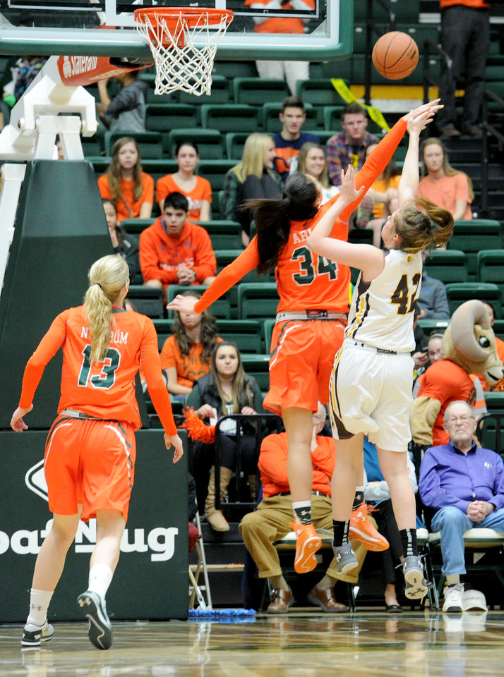 Alana Arias (34), Colorado State forward, blocks a shot from Marleah Campbell (42), Wyoming forward, during the first half, Saturday Jan. 30, 2016 in Fort Collins. (Photo by Trevor Davis/Loveland Reporter-Herald)