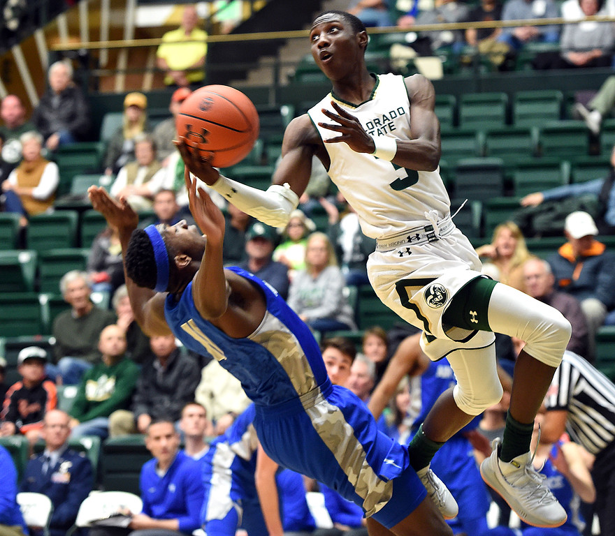 . Colorado State\'s Kendle Moore goes up for a shot as Air Force\'s Ameka Akaya falls while trying to block him during their game Tuesday, Jan. 8, 2019, at Moby Arena in Fort Collins.  (Photo by Jenny Sparks/Loveland Reporter-Herald)