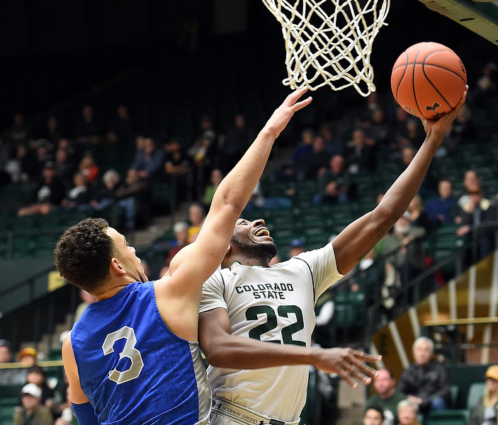 Colorado State's J.D. Paige goes up for a shot as Air Force's Sid Tomes tries to block during their game Tuesday, Jan. 8, 2019, at Moby Arena in Fort Collins.  (Photo by Jenny Sparks/Loveland Reporter-Herald)