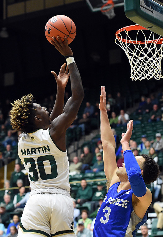 . Colorado State\'s Kris Martin goes up for a shot as Air Force\'s Sid Tomes tries to block during their game Tuesday, Jan. 8, 2019, at Moby Arena in Fort Collins.  (Photo by Jenny Sparks/Loveland Reporter-Herald)