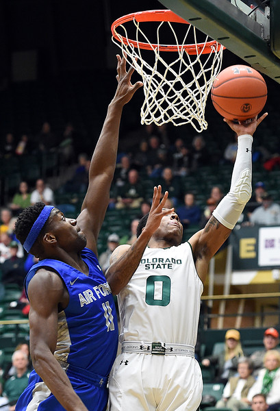 Colorado State's Hyron Edwards goes up for a shot as Air Force's Ameka Akaya tries to block during their game Tuesday, Jan. 8, 2019, at Moby Arena in Fort Collins.  (Photo by Jenny Sparks/Loveland Reporter-Herald)