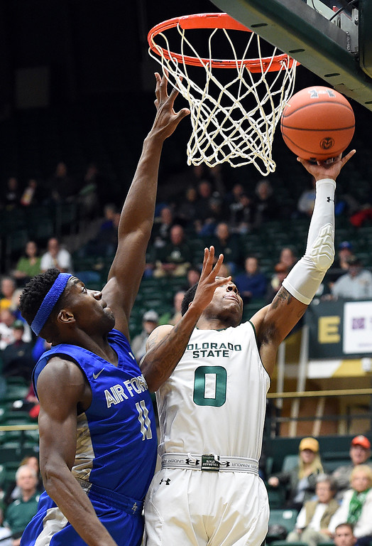 . Colorado State\'s Hyron Edwards goes up for a shot as Air Force\'s Ameka Akaya tries to block during their game Tuesday, Jan. 8, 2019, at Moby Arena in Fort Collins.  (Photo by Jenny Sparks/Loveland Reporter-Herald)