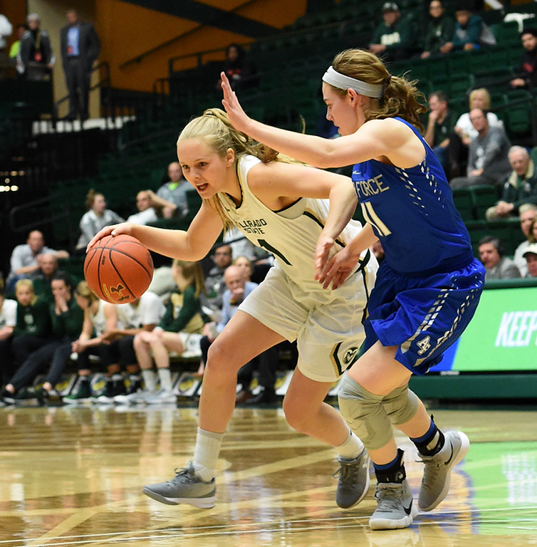 Colorado State's (1) Nathalie Linden powers her way through Air Force's (11) Cortney Porter's defense during their game on Wednesday, Feb. 7, 2018 at Moby Arena in Fort Collins. Photo by Thieng Mai/Loveland Reporter-Herald.