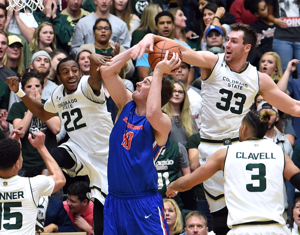 Colorado State's #22 J.D. Paige and #33 Braden Koelliker block a shot by Boise State's #10 Robin Jorch during their game Tuesday, Jan. 31, 2017, at Moby Arena in Fort Collins. (Photo by Jenny Sparks/Loveland Reporter-Herald)