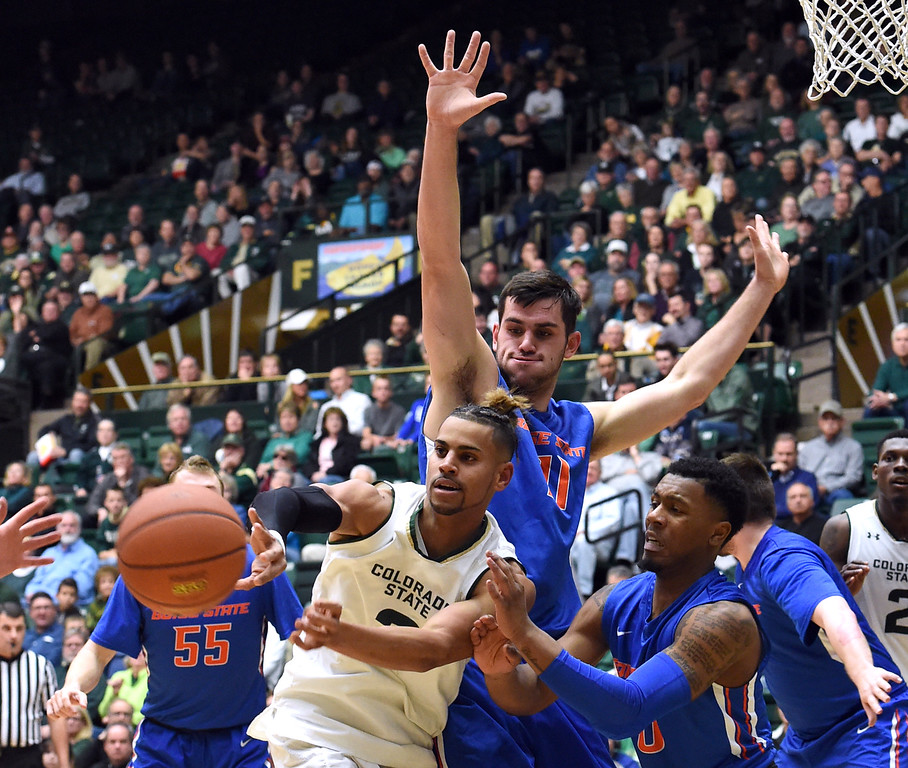 Colorado State's #3 Gian Clavell passes the ball as Boise State's #11 Zach Haney and #0 Marcus Dickinson try to block during their game Tuesday, Jan. 31, 2017, at Moby Arena in Fort Collins. (Photo by Jenny Sparks/Loveland Reporter-Herald)