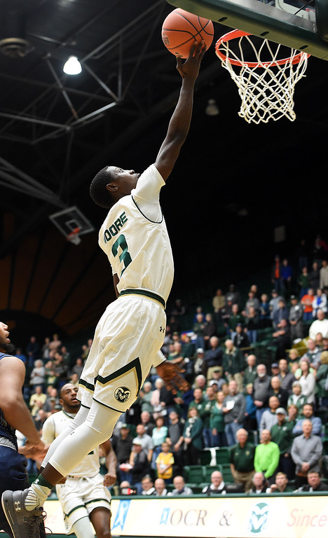 . Colorado State University\'s Kendle Moore goes up for a shot during their game against Montana Wednesday, Nov. 14, 2018, at Moby Arena in Fort Collins.  (Photo by Jenny Sparks/Loveland Reporter-Herald)