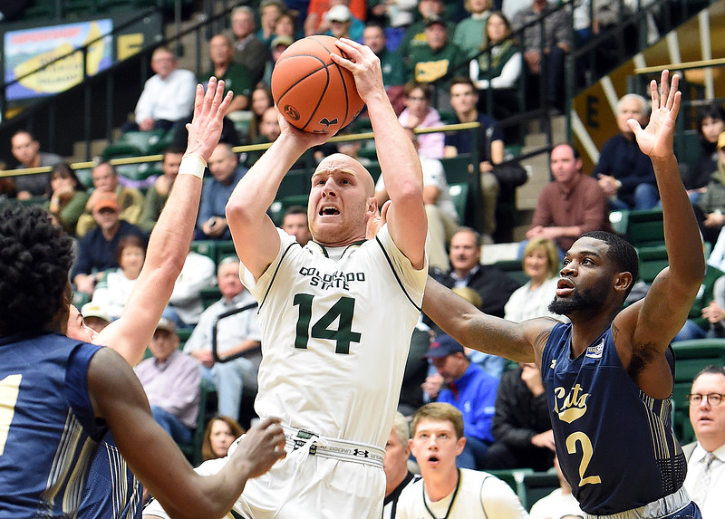 Colorado State University's Robbie Berwick goes up for a shot past Montana State's Devin Kirby during their game Wednesday, Nov. 14, 2018, at Moby Arena in Fort Collins.  (Photo by Jenny Sparks/Loveland Reporter-Herald)