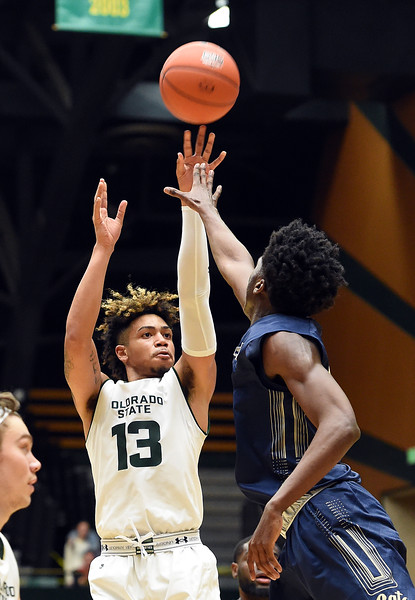 Colorado State University's Lorenzo Jenkins goes up for a shot past Montana State's Devin Kirby during their game Wednesday, Nov. 14, 2018, at Moby Arena in Fort Collins.  (Photo by Jenny Sparks/Loveland Reporter-Herald)