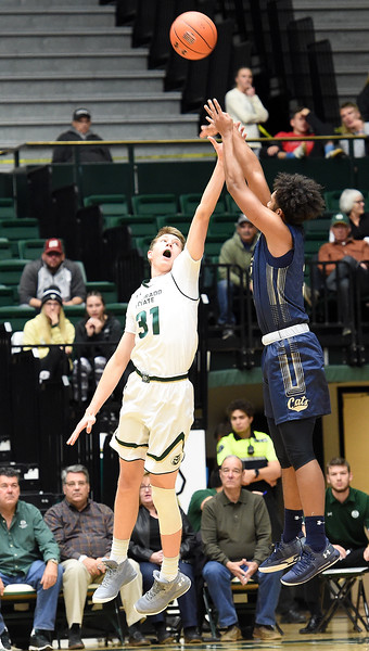 Colorado State University's Adam Thistlewood tries to block a shot by Montana State's Kendle Moore during their game Wednesday, Nov. 14, 2018, at Moby Arena in Fort Collins.  (Photo by Jenny Sparks/Loveland Reporter-Herald)