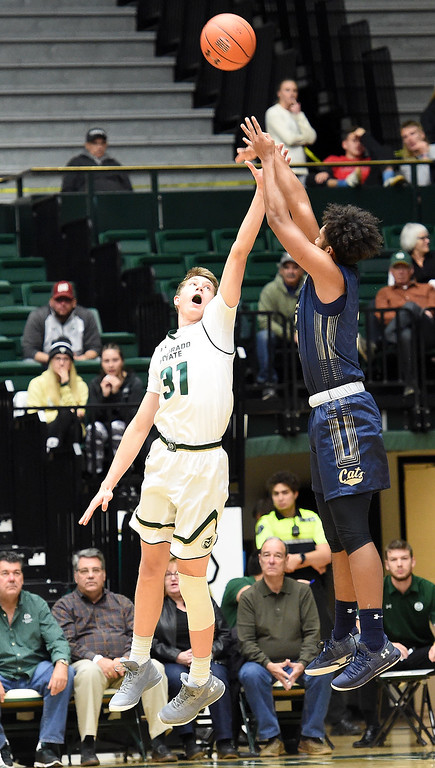 . Colorado State University\'s Adam Thistlewood tries to block a shot by Montana State\'s Kendle Moore during their game Wednesday, Nov. 14, 2018, at Moby Arena in Fort Collins.  (Photo by Jenny Sparks/Loveland Reporter-Herald)