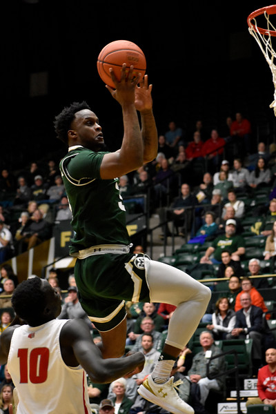 Colorado State's (3) Raquan Mitchell attempts a jump shot after getting past New Mexico's (10) Makuach Maluach during their game on Wednesday, Feb. 28, 2018 at Moby Arena in Fort Collins. Photo by Thieng Mai/Loveland Reporter-Herald.
