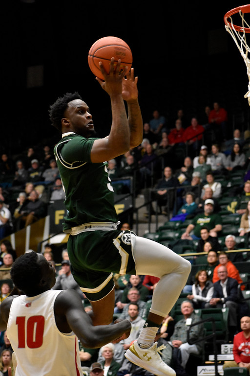 . Colorado State\'s (3) Raquan Mitchell attempts a jump shot after getting past New Mexico\'s (10) Makuach Maluach during their game on Wednesday, Feb. 28, 2018 at Moby Arena in Fort Collins. Photo by Thieng Mai/Loveland Reporter-Herald.