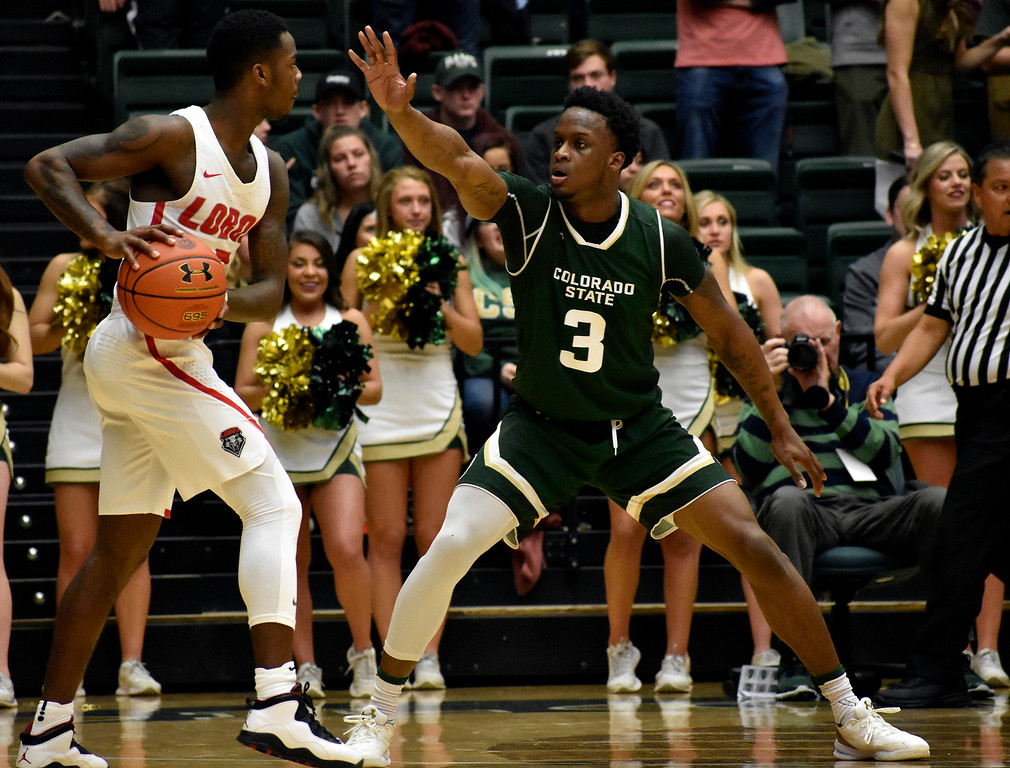 . Colorado State\'s (3) Raquan Mitchell playing defense against New Mexico\'s (3) Antino Jackson during their game on Wednesday, Feb. 28, 2018 at Moby Arena in Fort Collins. Photo by Thieng Mai/Loveland Reporter-Herald.