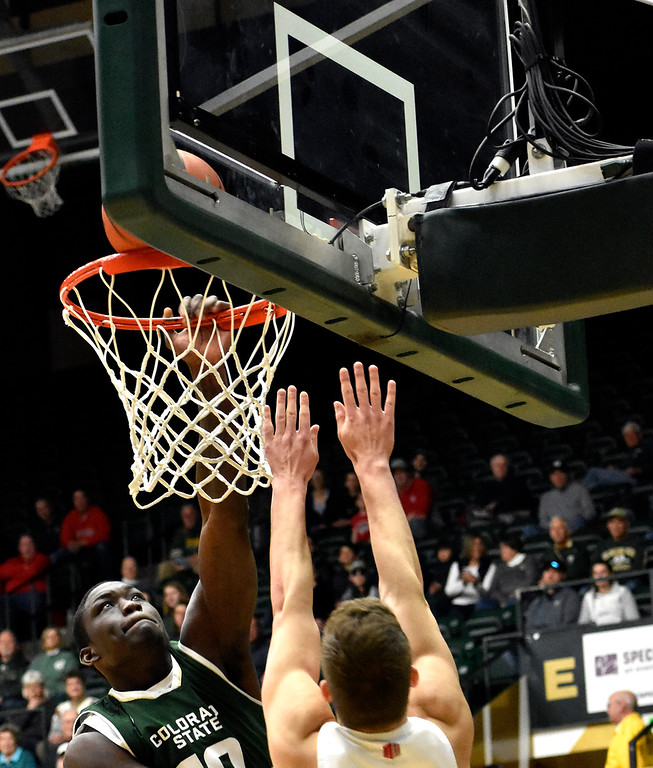 . Colorado State\'s (10) Che Bob goes for a slam dunk before New Mexico\'s (15) Vladimir Pinchuk can block him during their game on Wednesday, Feb. 28, 2018 at Moby Arena in Fort Collins. Photo by Thieng Mai/Loveland Reporter-Herald.