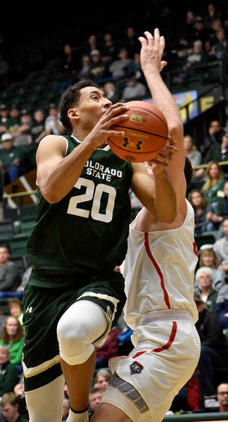 Colorado State's (20) Deion James breaks past New Mexico's (5) Joe Furstinger for a chance to score during their game on Wednesday, Feb. 28, 2018 at Moby Arena in Fort Collins. Photo by Thieng Mai/Loveland Reporter-Herald.
