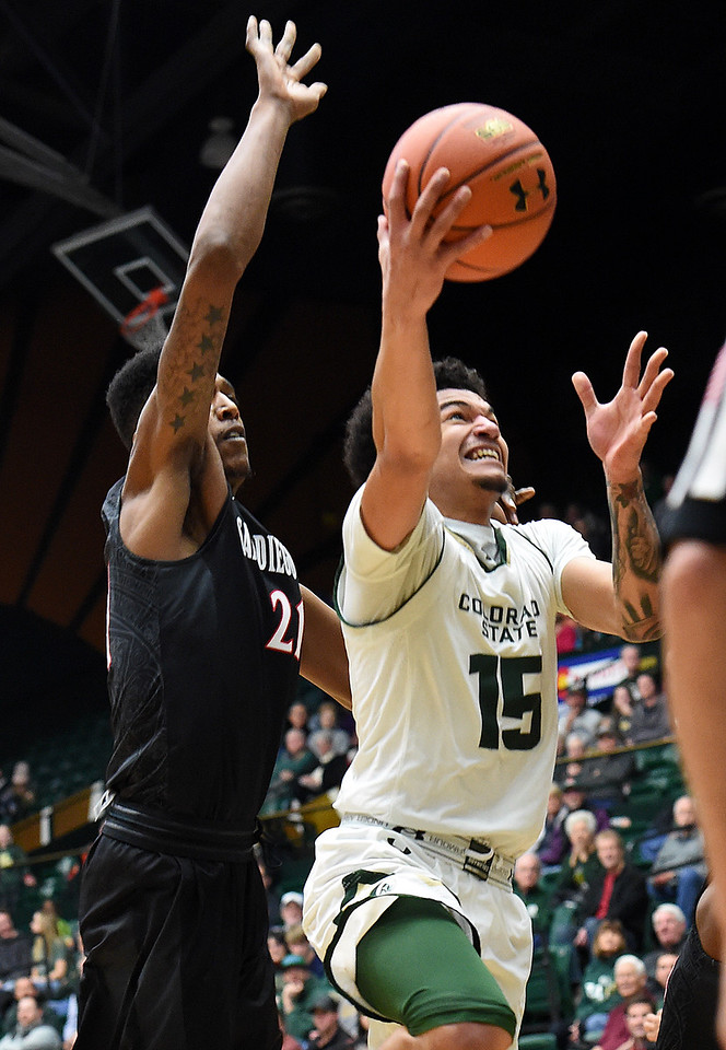 Colorado State University's (15) Anthony Bonner goes up for a shot as San Diego State's (21) Malik Pope tries to block during their game Tuesday, Jan. 2, 2018, at Moby Arena in Fort Collins. (Photo by Jenny Sparks/Loveland Reporter-Herald)