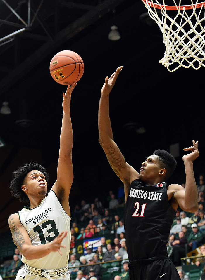 Colorado State University's (13) Lorenzo Jenkins goes up for a shot as San Diego State's (21) Malik Pope tries to block during their game Tuesday, Jan. 2, 2018, at Moby Arena in Fort Collins. (Photo by Jenny Sparks/Loveland Reporter-Herald)