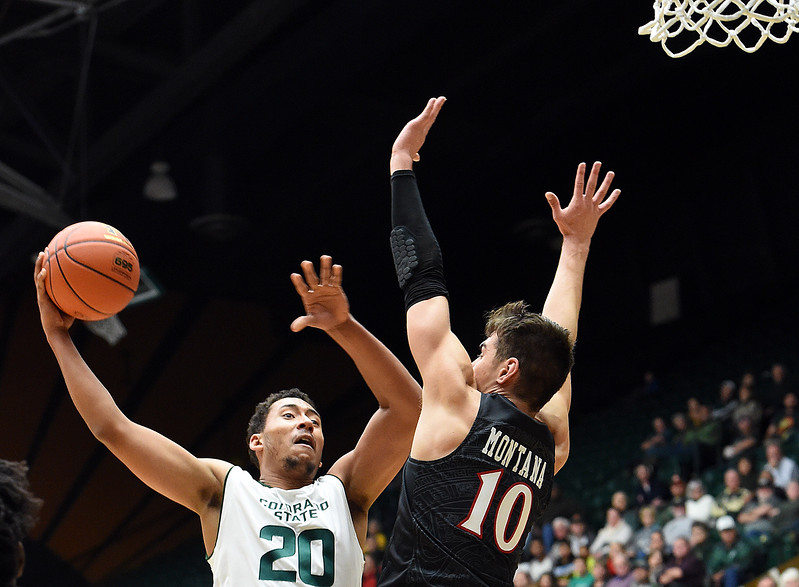 Colorado State University's (20) Deion James goes up for a shot as San Diego State's (10) Max Montana tries to block during their game Tuesday, Jan. 2, 2018, at Moby Arena in Fort Collins. (Photo by Jenny Sparks/Loveland Reporter-Herald)