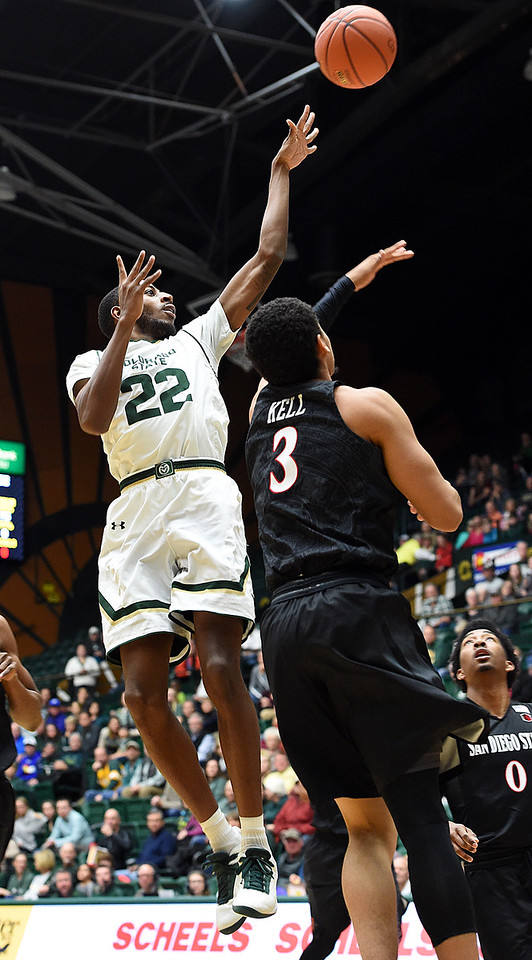 Colorado State University's (22) J.D. Paige goes up for a shot as San Diego State's (3) Trey Kell tries to block during their game Tuesday, Jan. 2, 2018, at Moby Arena in Fort Collins. (Photo by Jenny Sparks/Loveland Reporter-Herald)