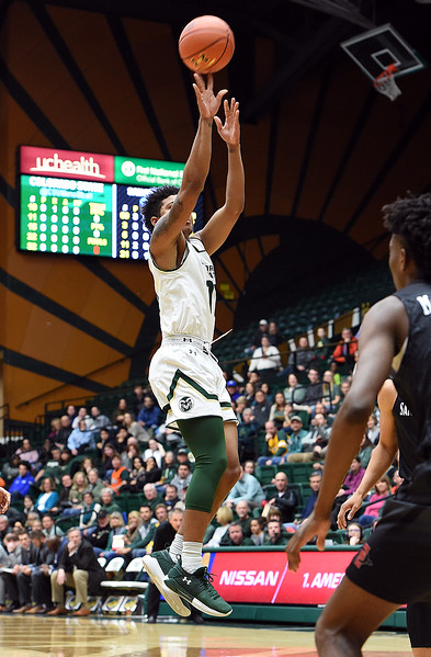 Colorado State University's (11) Prentiss Nixon goes up for a three-pointer during their game against San Diego State Tuesday, Jan. 2, 2018, at Moby Arena in Fort Collins. (Photo by Jenny Sparks/Loveland Reporter-Herald)