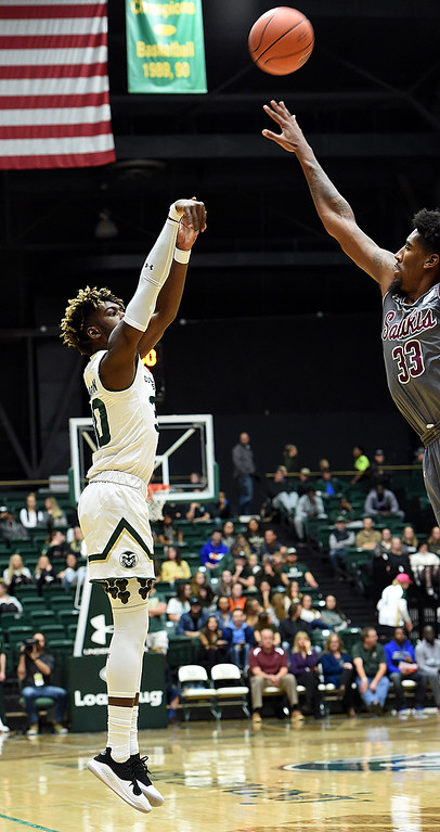 . Colorado State University\'s Kris Martin shoots a three-pointer as Southern Illinois\' Kavion Pippen tries to block during their game Tuesday, Nov. 27, 2018, at Moby Arena in Fort Collins.    (Photo by Jenny Sparks/Loveland Reporter-Herald)