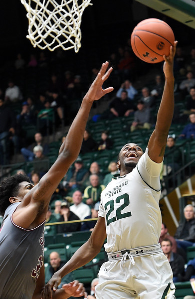 Colorado State University's J.D. Paige goes up for a shot as Southern Illinois' Kavion Pippen tries to block during their game Tuesday, Nov. 27, 2018, at Moby Arena in Fort Collins.    (Photo by Jenny Sparks/Loveland Reporter-Herald)