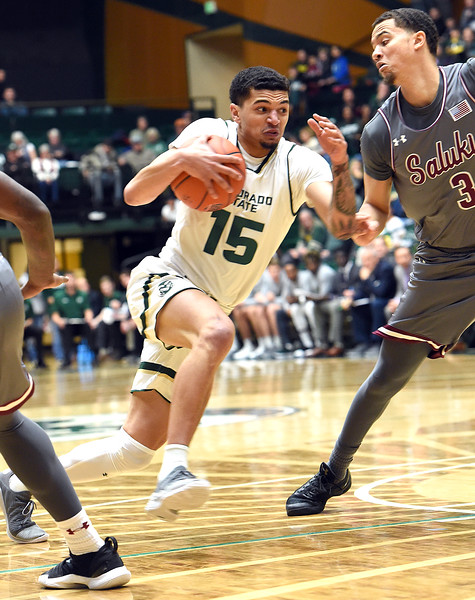 Colorado State University's Anthony Masinton-Bonner takes the ball down court past Southern Illinois' Marcus Bartley during their game Tuesday, Nov. 27, 2018, at Moby Arena in Fort Collins.    (Photo by Jenny Sparks/Loveland Reporter-Herald)