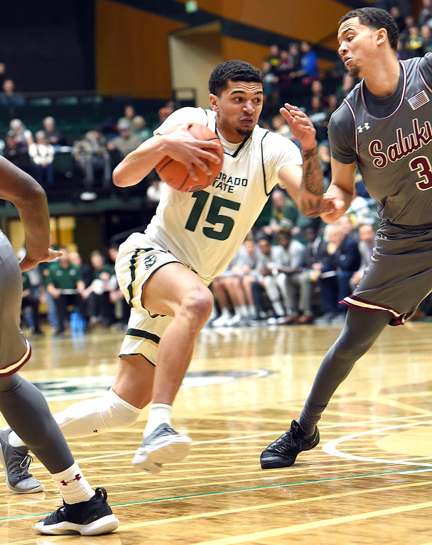 . Colorado State University\'s Anthony Masinton-Bonner takes the ball down court past Southern Illinois\' Marcus Bartley during their game Tuesday, Nov. 27, 2018, at Moby Arena in Fort Collins.    (Photo by Jenny Sparks/Loveland Reporter-Herald)