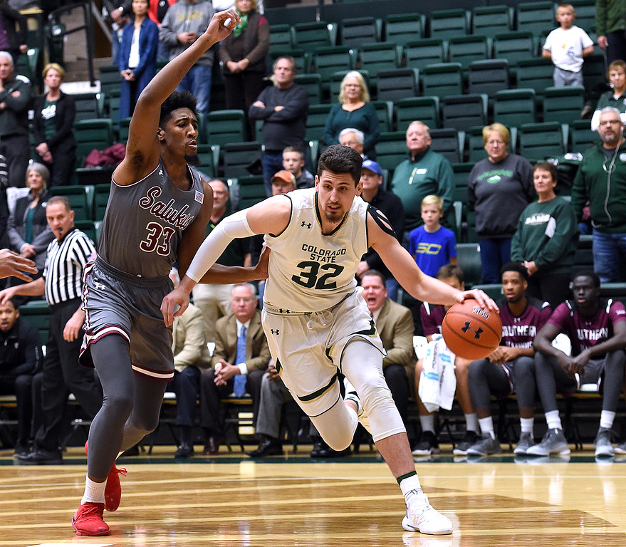. Colorado State University\'s Nico Carvacho gets past Southern Illinois\' Kavion Pippen during their game Tuesday, Nov. 27, 2018, at Moby Arena in Fort Collins.    (Photo by Jenny Sparks/Loveland Reporter-Herald)