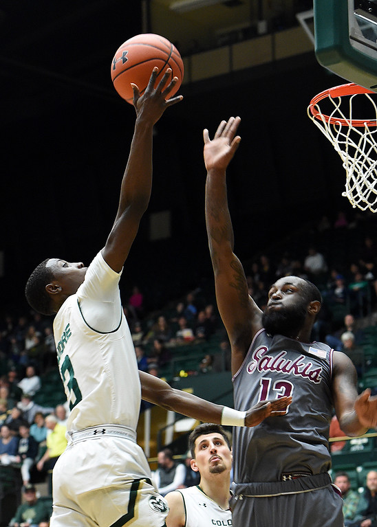 . Colorado State University\'s Kendle Moore goes up for a shot as Southern Illinois\' Sean Lloyd Jr. tries to block during their game Tuesday, Nov. 27, 2018, at Moby Arena in Fort Collins.    (Photo by Jenny Sparks/Loveland Reporter-Herald)