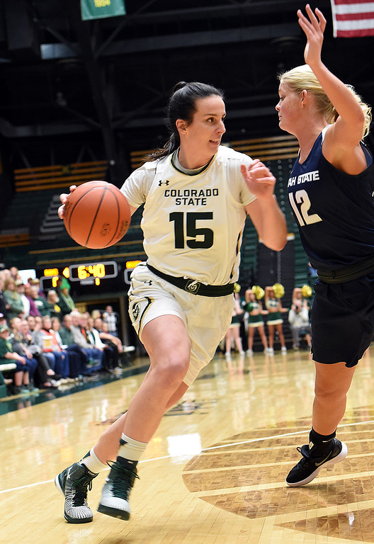 . Colorado State\'s (15) Stine Veronika Mirkovic gets past Utah State\'s (12) Hailey Bassett during their game on Wednesday, Jan 10, 2018, at Moby Arena in Fort Collins.  (Photo by Jenny Sparks/Loveland Reporter-Herald)