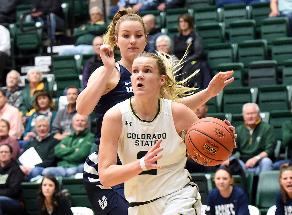 . Colorado State\'s (2) Stine Austgulen gets past Utah State\'s (22) Rachel Brewster during their game on Wednesday, Jan 10, 2018, at Moby Arena in Fort Collins.  (Photo by Jenny Sparks/Loveland Reporter-Herald)