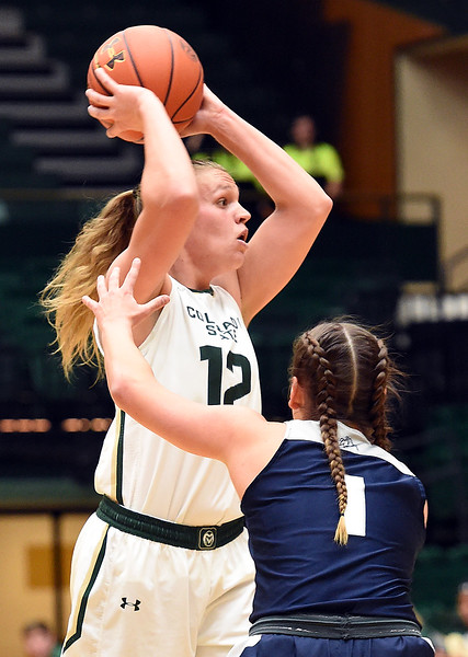Colorado State's (12) Callie Kaiser looks to pass as Utah State's (1) Eliza West tries to block during their game on Wednesday, Jan 10, 2018, at Moby Arena in Fort Collins.  (Photo by Jenny Sparks/Loveland Reporter-Herald)
