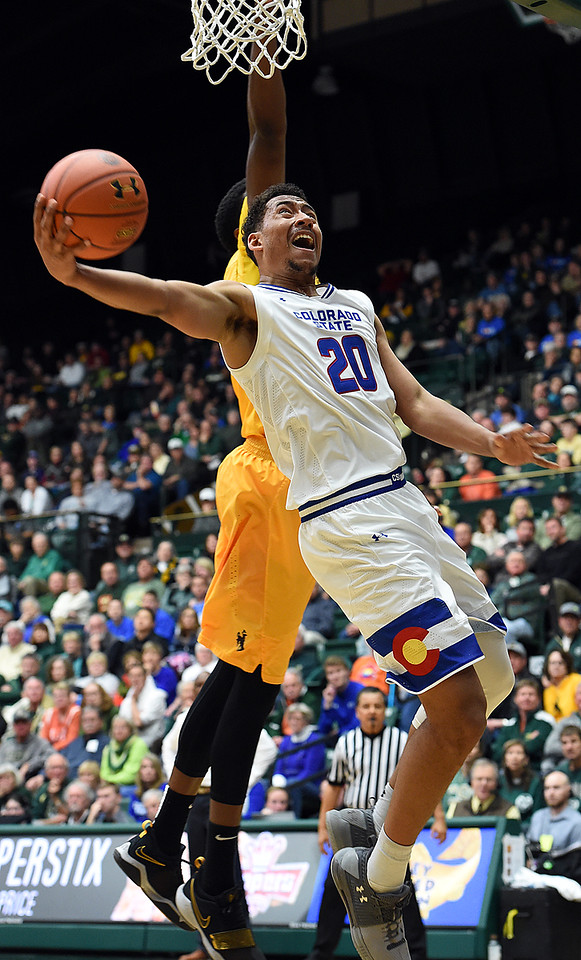 Colorado State University's (20) Deion James goes up for a shot during their game against Wyoming on Wednesday, Jan. 31, 2018, at Moby Arena in Fort Collins. (Photo by Jenny Sparks/Loveland Reporter-Herald)