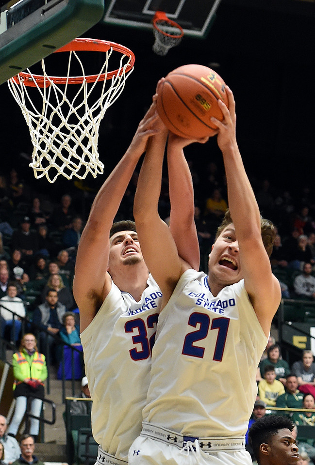 Colorado State University's (32) Nico Carvacho and (21) Logan Ryan go up for a rebound during their game against Wyoming  Wednesday, Jan. 31, 2018, at Moby Arena in Fort Collins. (Photo by Jenny Sparks/Loveland Reporter-Herald)