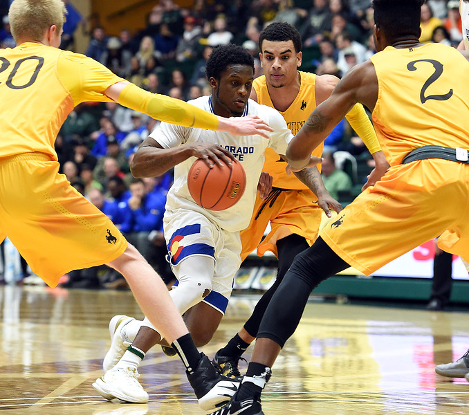 Colorado State University's (3) Raquan Mithell drives the ball downcourt past a pack of Wyoming players during their game Wednesday, Jan. 31, 2018, at Moby Arena in Fort Collins. (Photo by Jenny Sparks/Loveland Reporter-Herald)