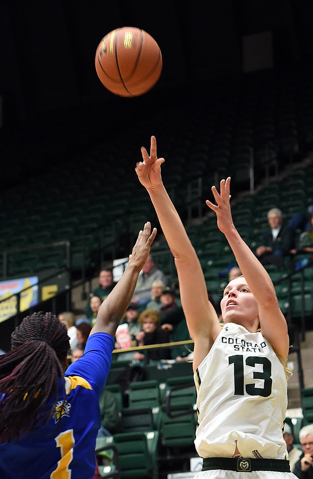 Colorado State University's #13 Ellen Nystrom goes up for a shot as San Jose State's #1 Myzhanique Ladd tries to block during their game Wednesday, Jan. 4, 2017, at Moby Arena in Fort Collins. (Photo by Jenny Sparks/Loveland Reporter-Herald)