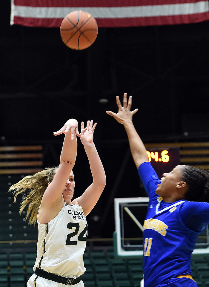 Colorado State University's #24 Amanda Kantzy goes up for a shot as San Jose State's #11 Jasmine Smith tries to block during their game Wednesday, Jan. 4, 2017, at Moby Arena in Fort Collins. (Photo by Jenny Sparks/Loveland Reporter-Herald)