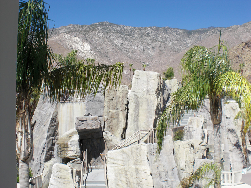 Palm Canyon Resort--view of back of waterslides with top deck -chairs and tables