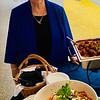Marie Sweeney of Tewksbury prepares to sample some of teh appetizers.