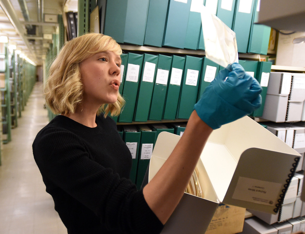 . Katelyn Morken, project archivist, goes through  negatives from the Japanese University.  The CU Boulder Archives turned 100 this year. Cliff Grassmick  Staff Photographer  June 26, 2018