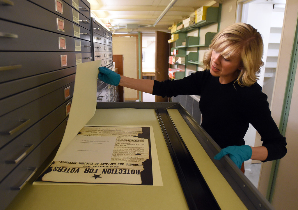 . Katelyn Morken, project archivist, goes through materials in the archives.  The CU Boulder Archives turned 100 this year. Cliff Grassmick  Staff Photographer  June 26, 2018