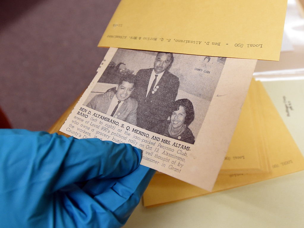 . Katelyn Morken, project archivist, goes through photographs from the Salt of the Earth Strikes.   The CU Boulder Archives turned 100 this year. Cliff Grassmick  Staff Photographer  June 26, 2018