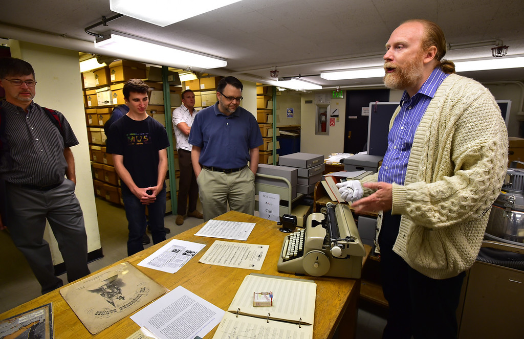 . Eric Harbeson, Assistant Professor of the Music Special Collections and the Curator of the American Music Research Center shows off a Musicwriter developed by a CU professor. It was part of the tour of the Special Collections Archives and Preservation in the Norlin Library on the University of Colorado Boulder Campus on Wednesday afternoon.  For more photos go to dailycamera.com Paul Aiken Staff Photographer June 6, 2018
