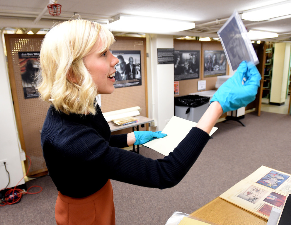 . Katelyn Morken, project archivist, goes through photographs and negatives from the Salt of the Earth Strikes.  The CU Boulder Archives turned 100 this year. Cliff Grassmick  Staff Photographer  June 26, 2018