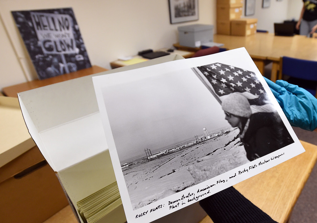 . Katelyn Morken, project archivist, goes through Robert Godfrey�s Rocky Flats photographs. The CU Boulder Archives turned 100 this year. Cliff Grassmick  Staff Photographer  June 26, 2018
