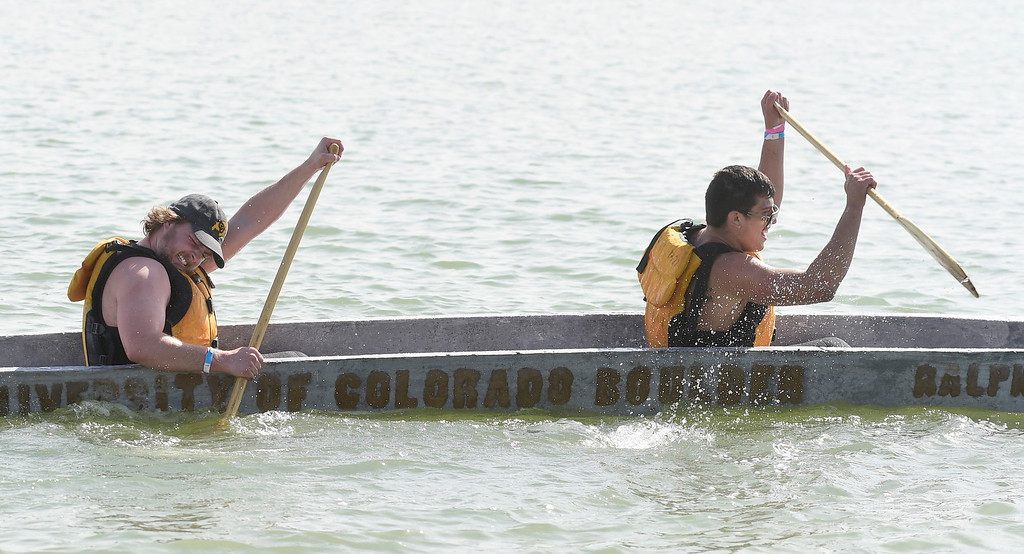 . BOULDER, CO - April 6, 2019:   Alec Guevara, right, and Mason Bell, of CU, push it to the finish. CU Boulder�s student chapter of the American Society of Civil Engineers hosted the 2019 Rocky Mountain Student Conference. The concrete canoe races, at the Boulder Reservoir, are one of the highlights. The annual event provides civil engineering students with an opportunity to gain hands-on practical experience and leadership skills by using concrete to design, build and test viable watercraft. (Photo by Cliff Grassmick/Staff Photographer)