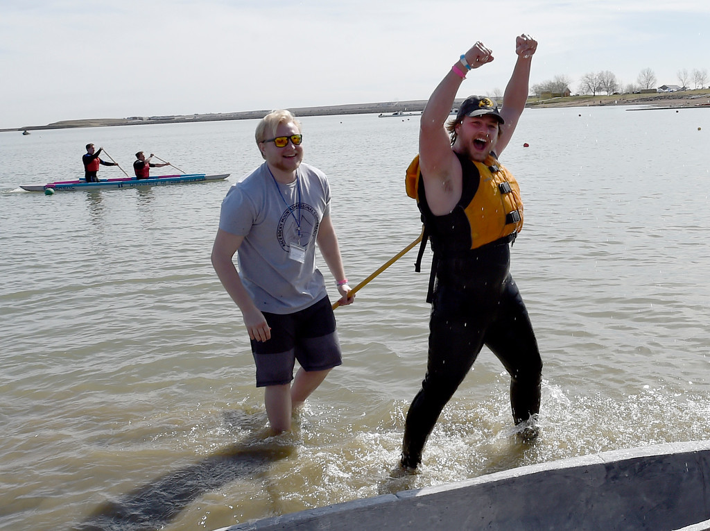 . BOULDER, CO - April 6, 2019:  Mason Bell, right, celebrates his 3rd-place finish for the Buffs. CU Boulder�s student chapter of the American Society of Civil Engineers hosted the 2019 Rocky Mountain Student Conference. The concrete canoe races, at the Boulder Reservoir, are one of the highlights. The annual event provides civil engineering students with an opportunity to gain hands-on practical experience and leadership skills by using concrete to design, build and test viable watercraft. (Photo by Cliff Grassmick/Staff Photographer)