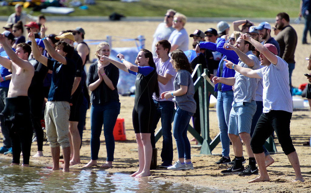 . BOULDER, CO - April 6, 2019:  Spectators give instructions from the shore to the racers. CU Boulder�s student chapter of the American Society of Civil Engineers hosted the 2019 Rocky Mountain Student Conference. The concrete canoe races, at the Boulder Reservoir, are one of the highlights. The annual event provides civil engineering students with an opportunity to gain hands-on practical experience and leadership skills by using concrete to design, build and test viable watercraft. (Photo by Cliff Grassmick/Staff Photographer)